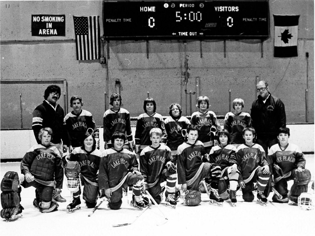 Lake Placid PeeWee Association Coach, Butch Martin with his team
