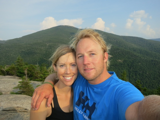 Andrew with his wife, Denja, by a mountain