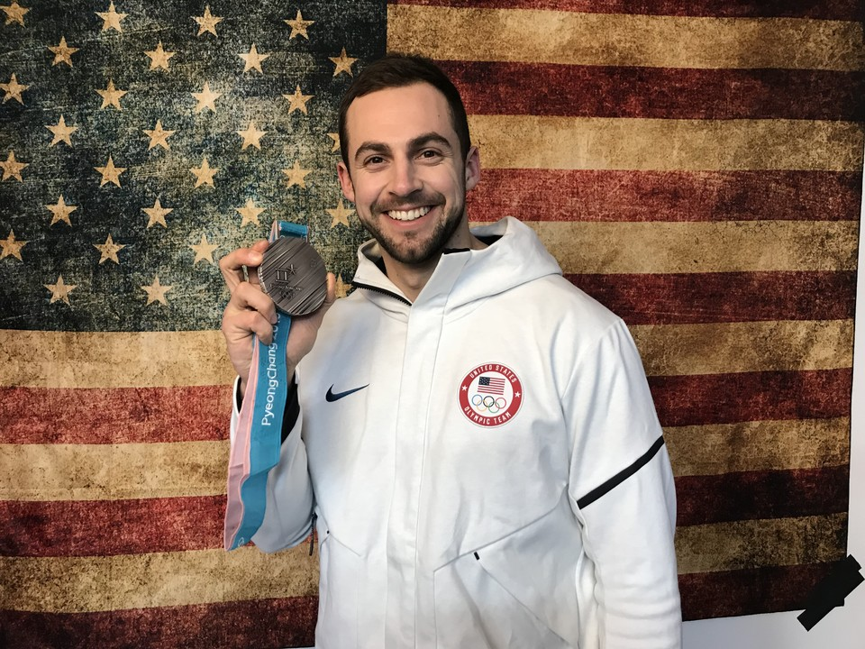 Chris Mazdzer with his silver Olympic medal and American flag