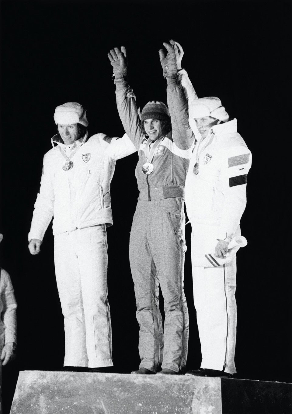 Eric Heiden on the Olympic podium with hands in the air