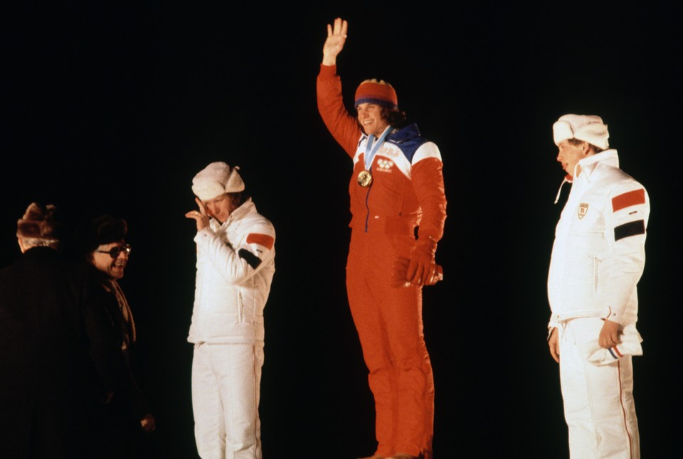 Eric Heiden on the Olympic podium while waving at crowd