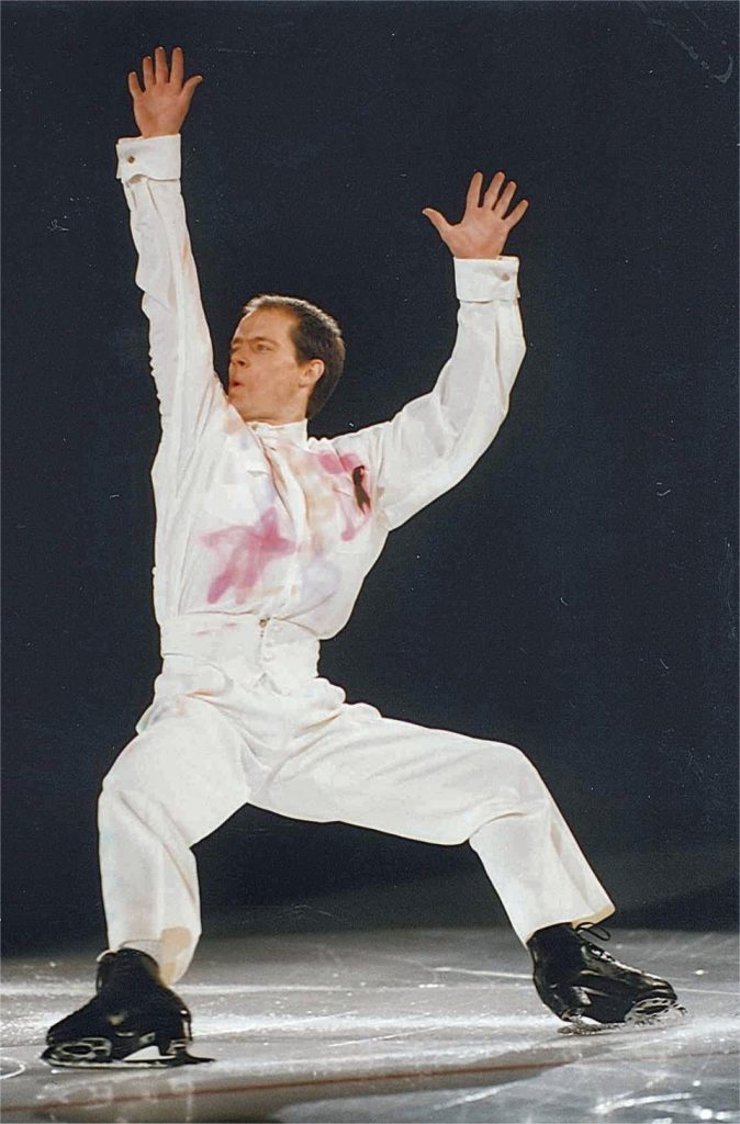 Kurt Browning skating with arms in the air, 1996