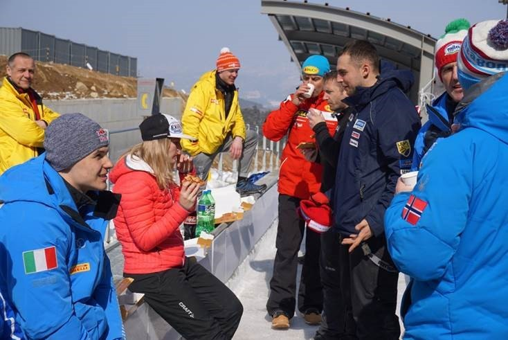 Chris Mazdzer with Italian, German and Austrian friends and competitors
