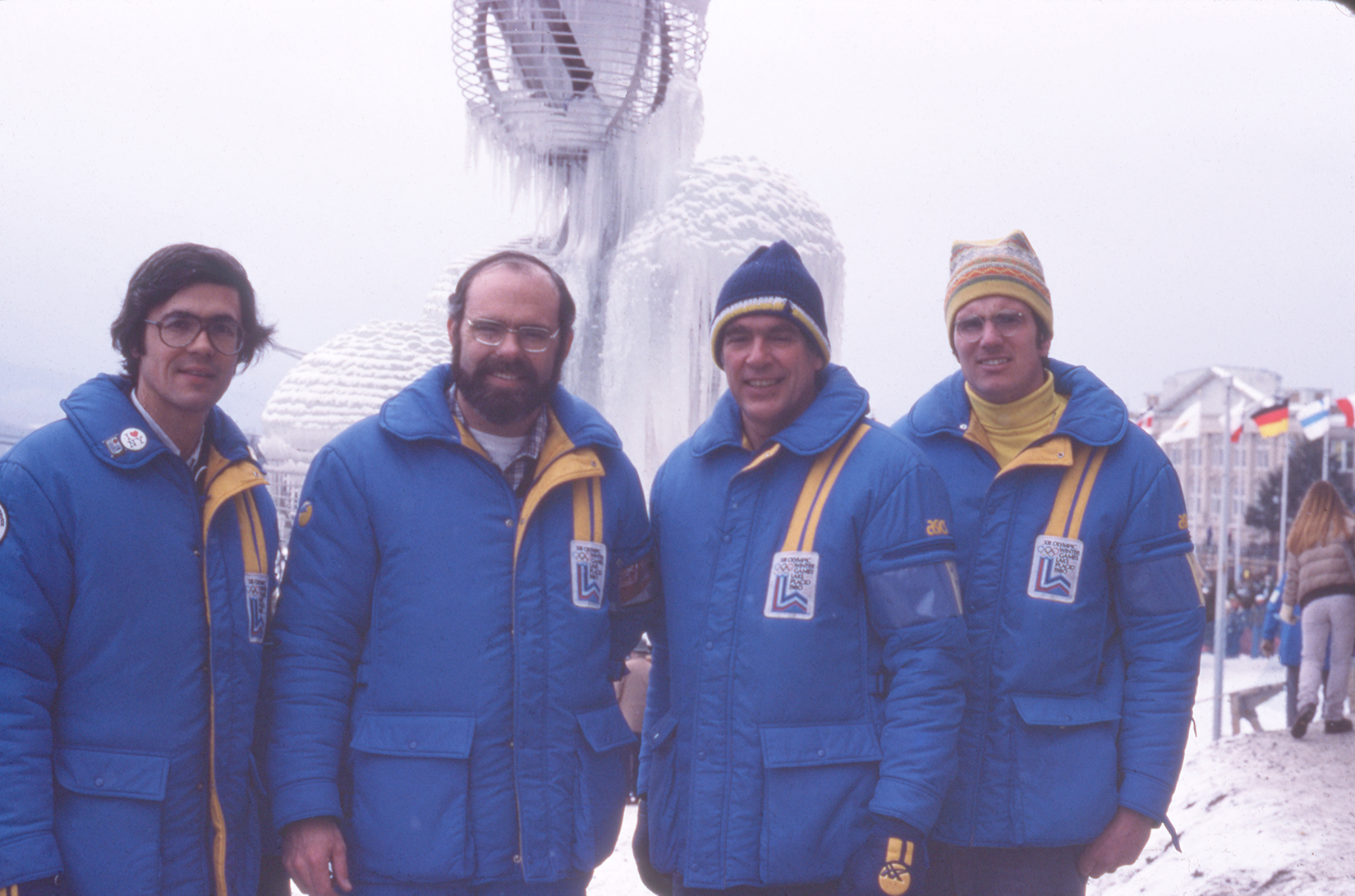 Four men wearing blue snowsuits in Lake Placid, NY