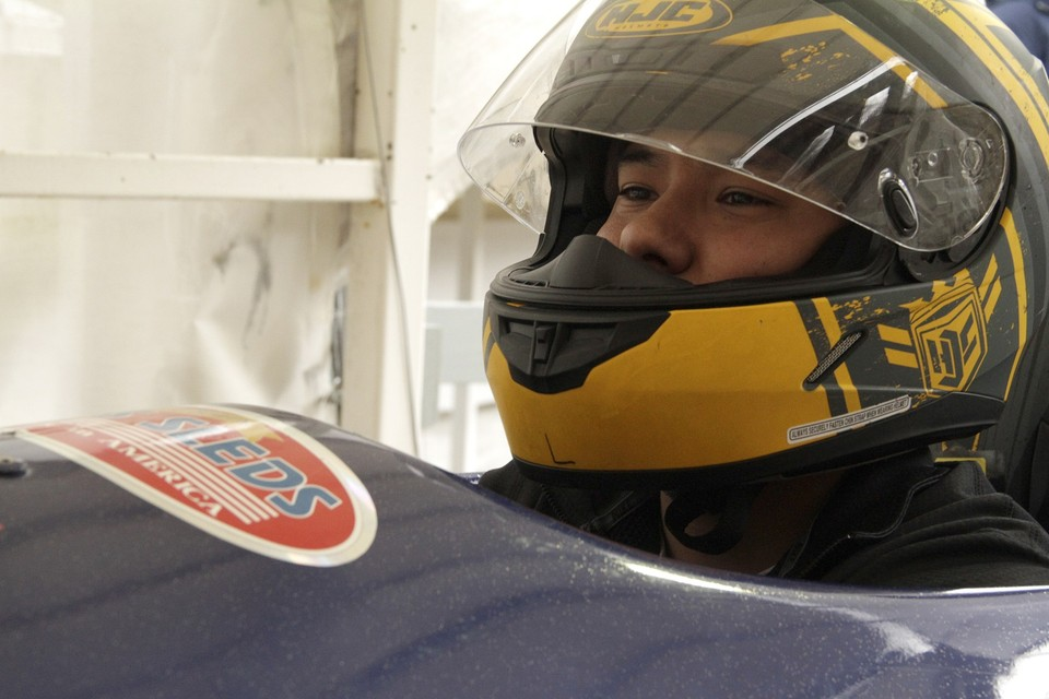 Close up of Bobsled driver in yellow helmet