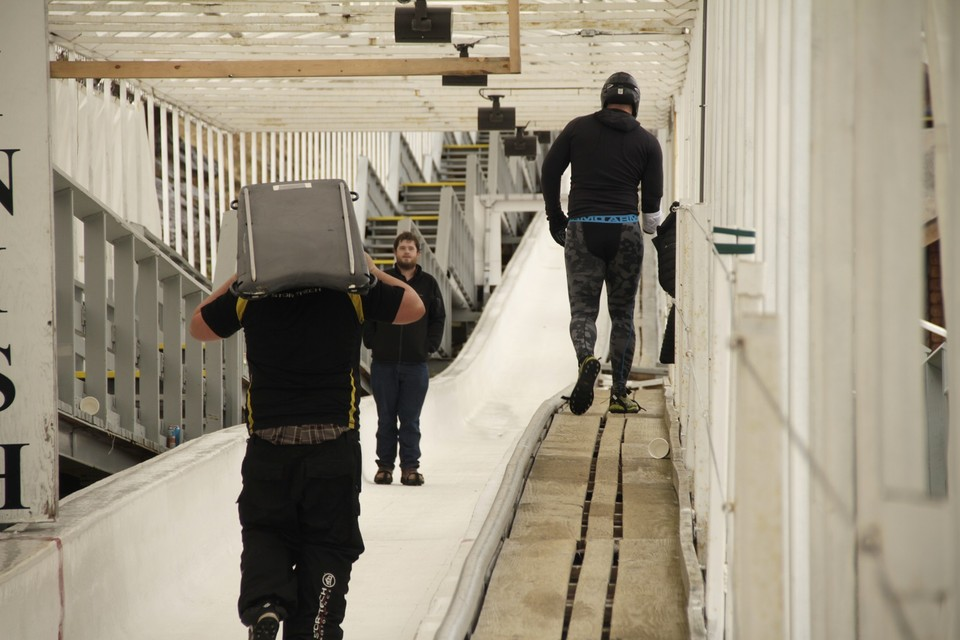 Bobsled Track workers and sliders