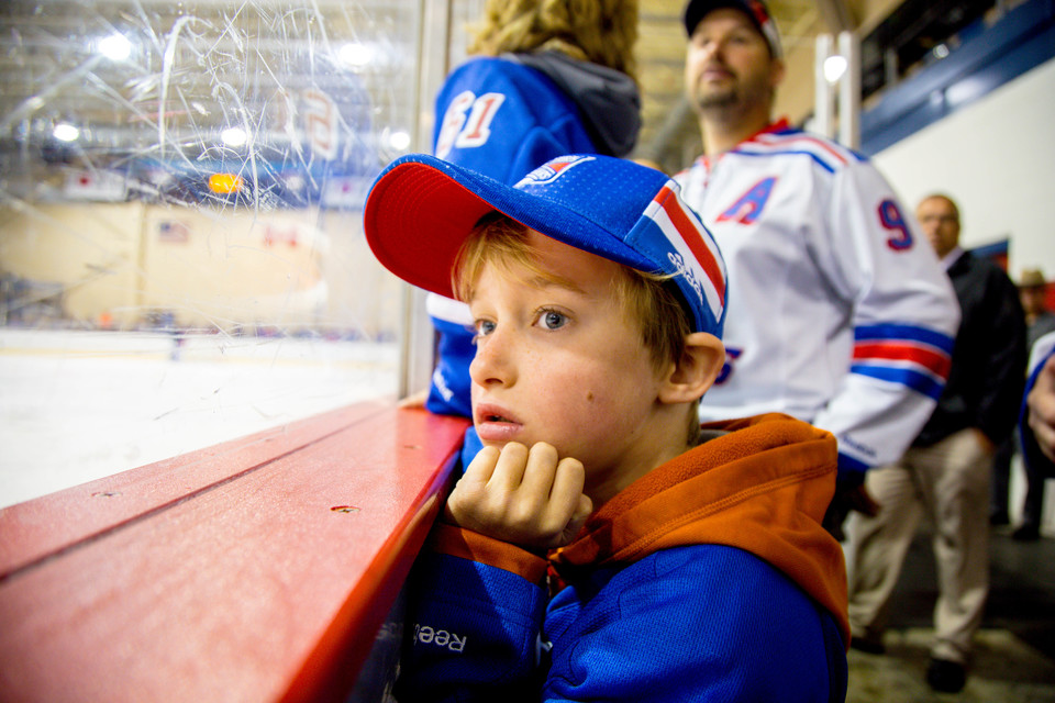 Close up of boy in Ranger's hat at ice rink