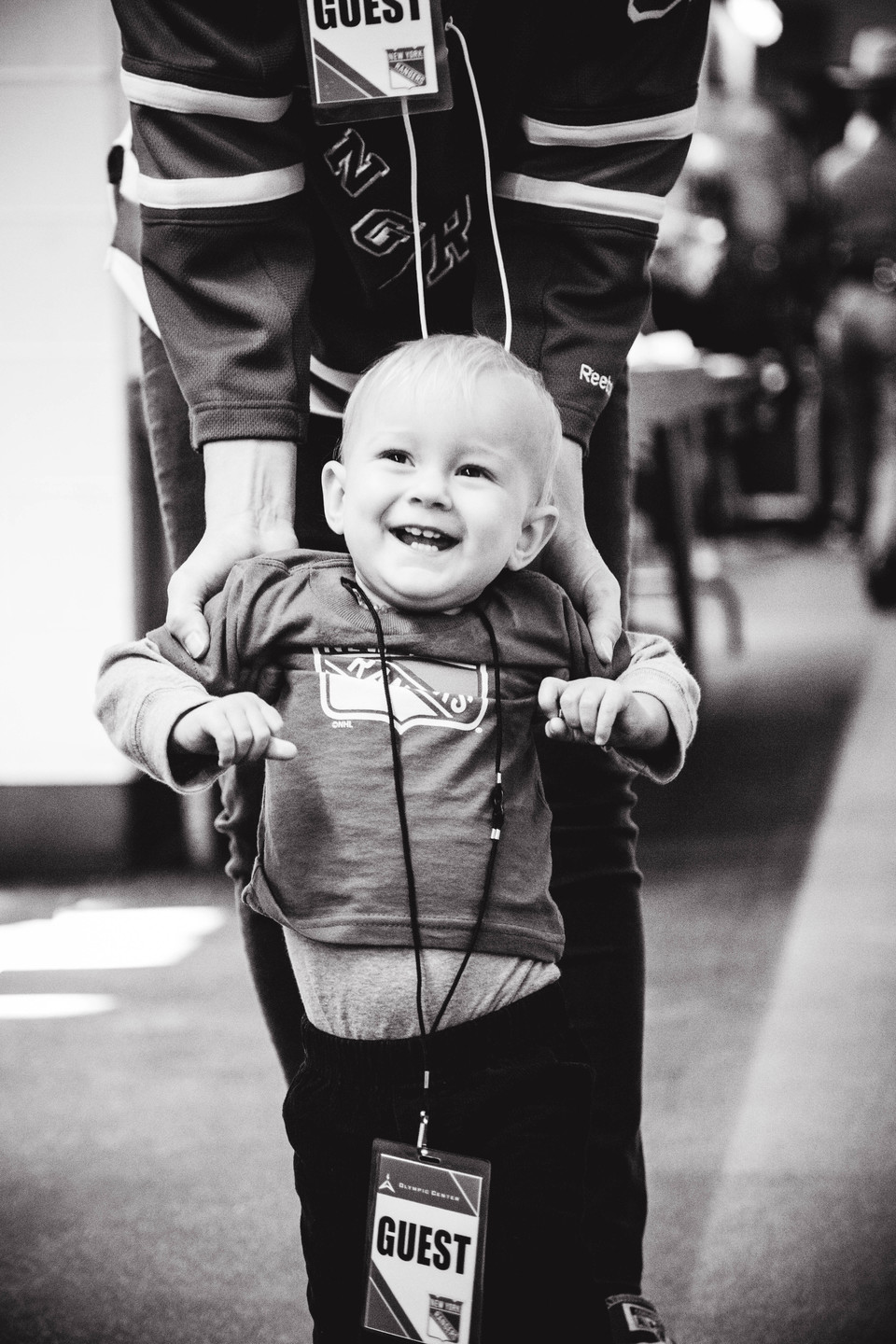 Male toddler wearing rangers shirt with a guest pass in black and white