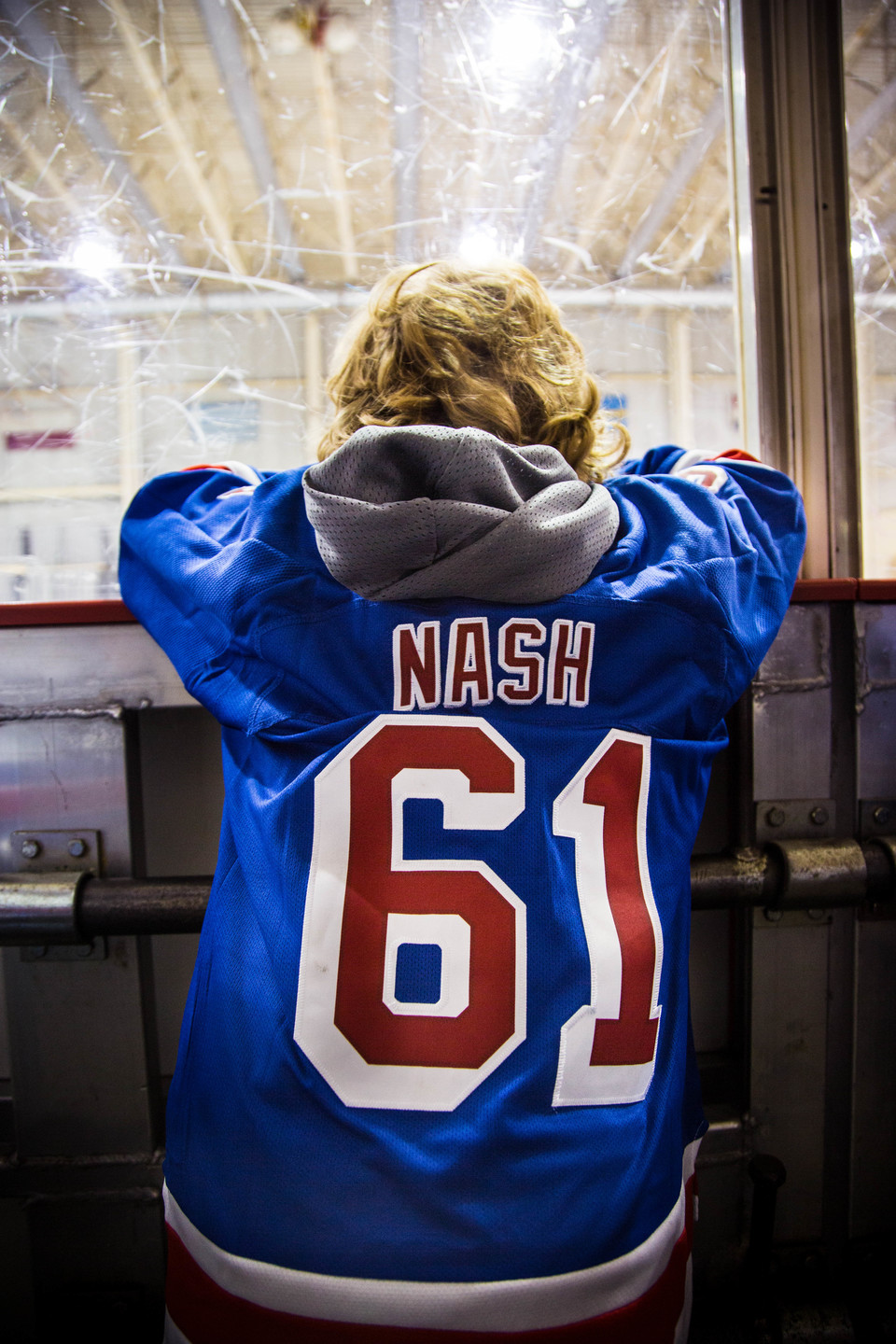 """Close up of the back of boy's hockey jersey which says """"NASH"""""""