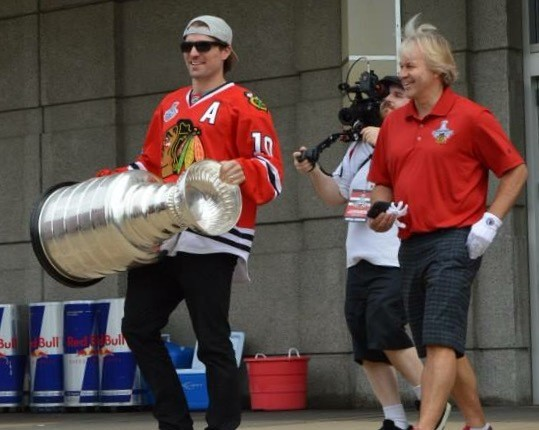 Phil Pritchard follows as Chicago Blackhawk, Patrick Sharp carries the Stanley Cup. Photo courtesy of HHOF Archives