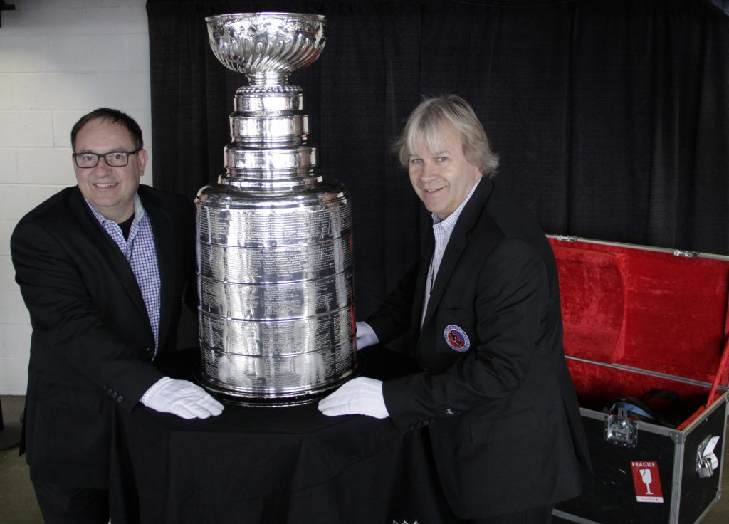 Phil Pritchard and Mario Della-Savia with the Stanely Cup in Lake Placid, NY for ECAC hockey in March 2016