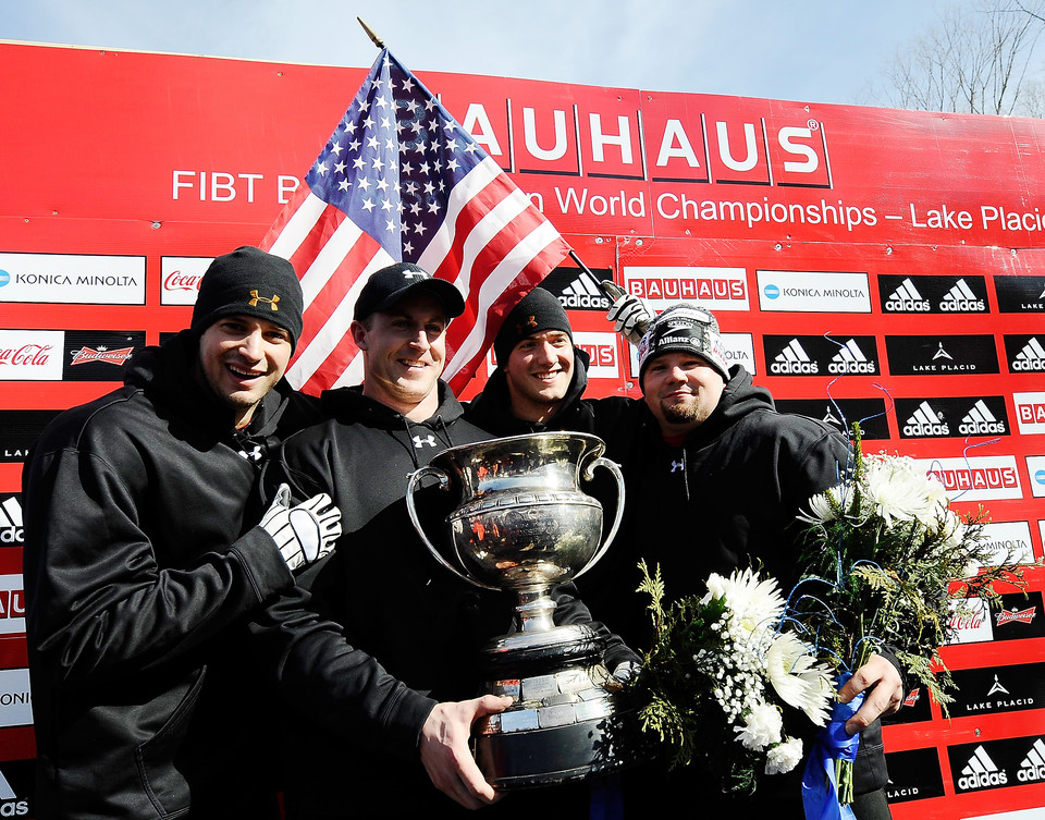 Steve Mesler, Curtis Tomasevicz ,Justin Olsen, and Steven Holcomb of The United States celebrates their gold medal win of the men's 4-Man Bobsleigh at the FIBT Bobsleigh and Skeleton World Championships held at Lake Placid New York USA 1 March 2009.