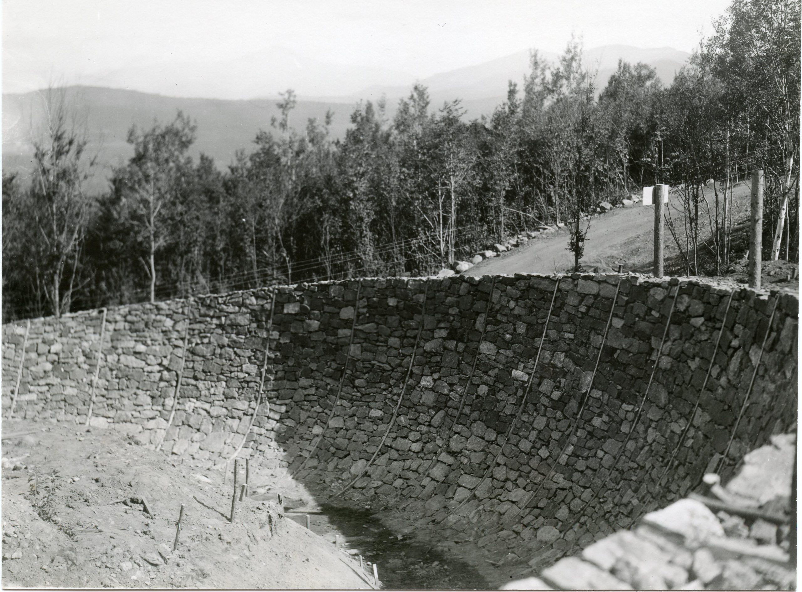 A curve in the track constructed out of rock forged on site at Mt. Van Hoevenberg