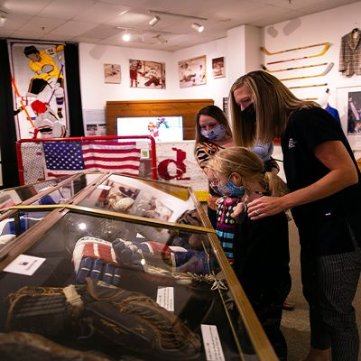 Museum Guests Look at Artifacts