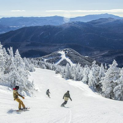 Snowboarders on the Follies